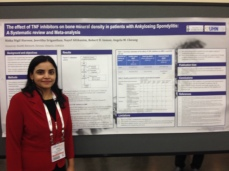 Dr. Nisha Nigil Haroon, Clinical Fellow at the Osteoporosis Program, next to her poster describing the effect that medication (TNF inhibitors) used to treat ankylosing spondylitis (AS) has on bone density and whether this class of medications can be used to treat bone loss in patients with AS.